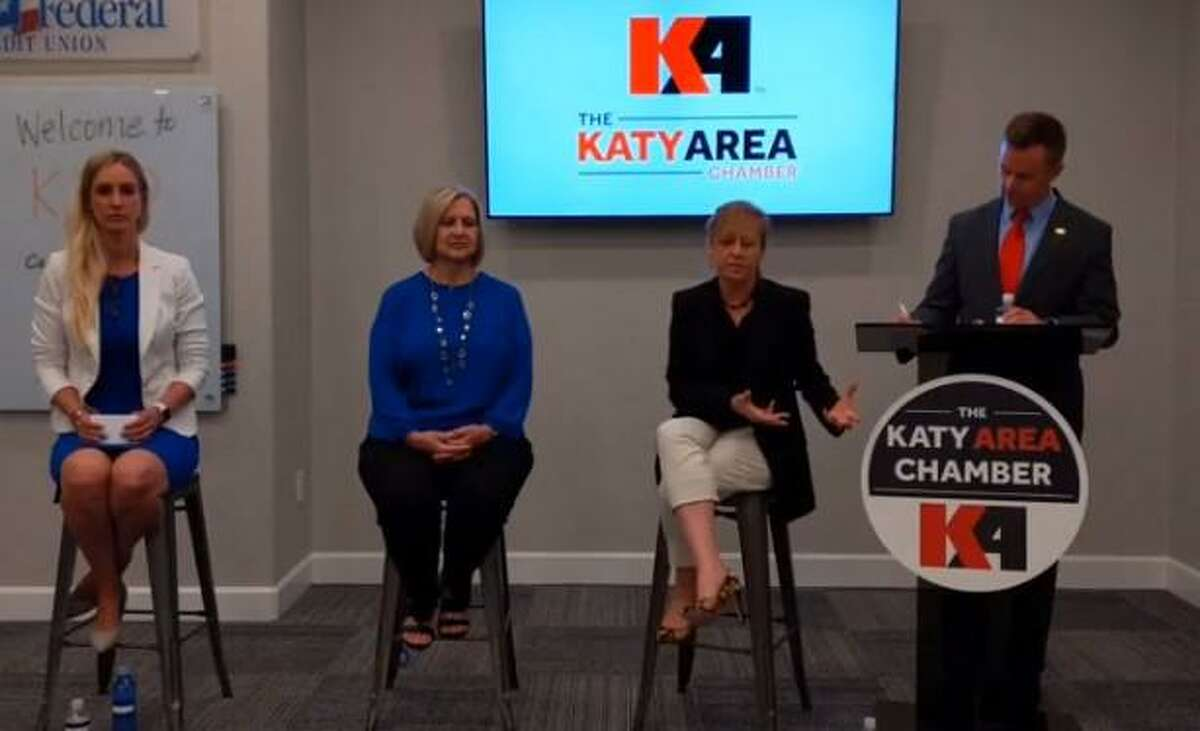 From left, Bonnie Anderson, Rebecca Fox and Susan Gesoff discuss Katy ISD issues at Katy Area Chamber of Commerce forum moderated by Jason Burdine on Thursday.