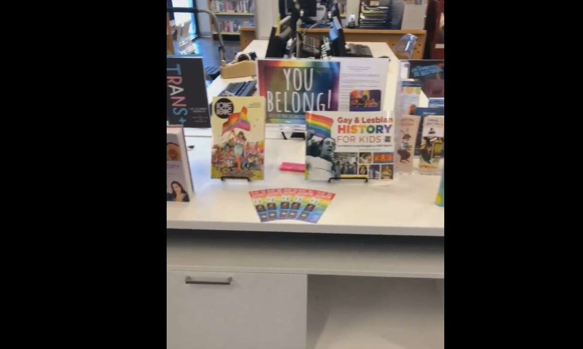 """A video of one of the Pride displays posted on Facebook on June 4 shows children's LGBT books, rainbow bookmarks, a """"Millions of moments of pride"""" rainbow banner, and a """"You belong!"""" sign. The post received positive feedback."""