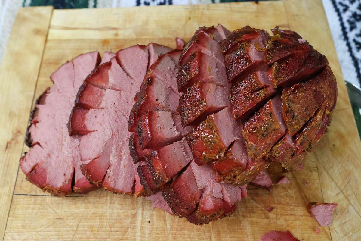 Smoked beef bologna, a barbecue staple in nearby Oklahoma, sliced into approximately half-pound slices.