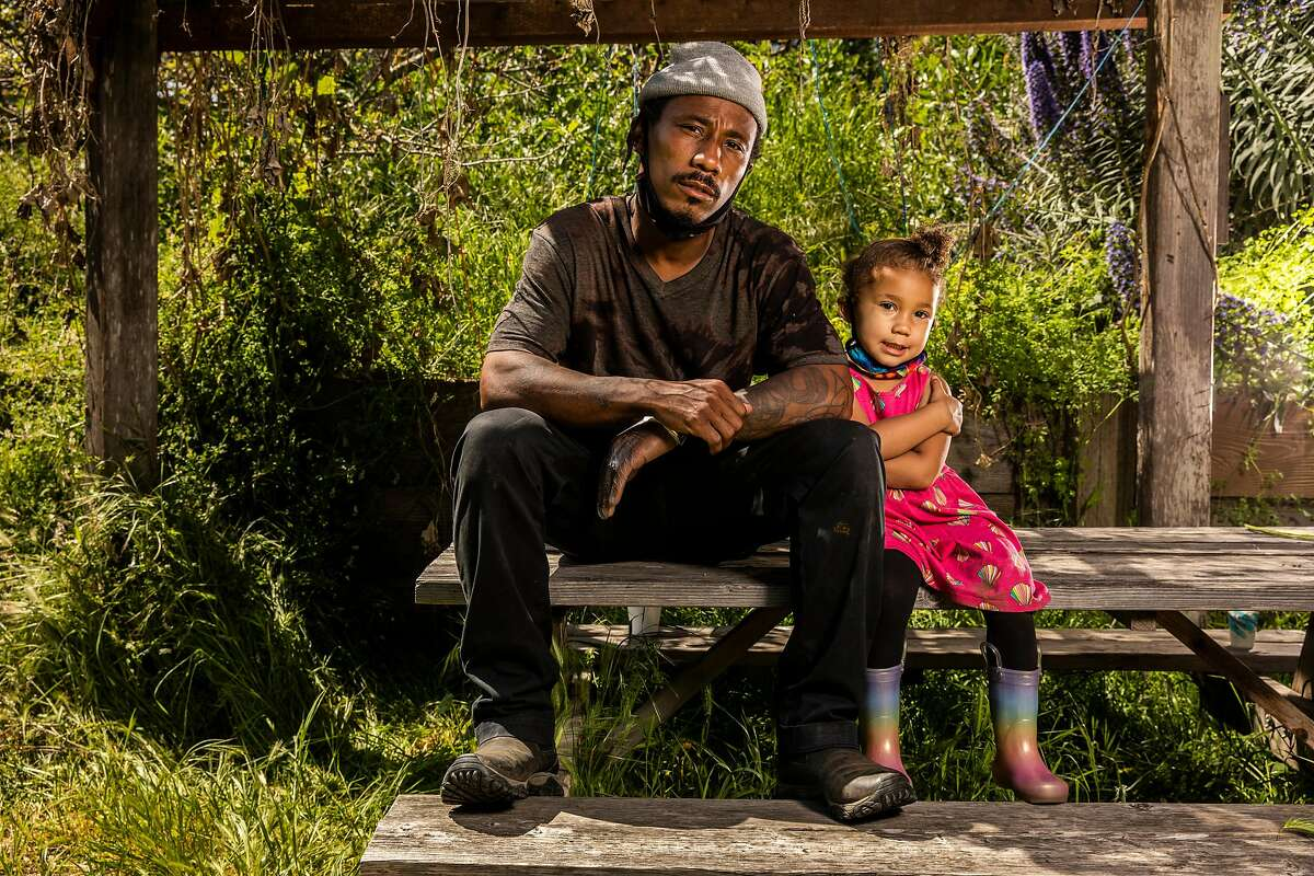 Christoper Renfro with daughter Ahmarie, 3, at Alemany Farm.