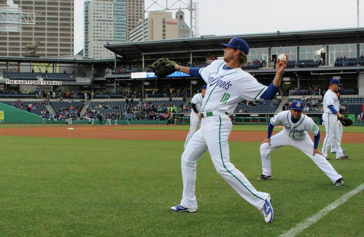 FILE - In this April 13, 2017 file photo, Hartford Yard Goats players warm up before the team's first ever game in Hartford, Conn. The Double-A team say they are going peanut-free at the 6,000-seat Dunkin' Donuts Park in 2019 to make the venue safer for people with nut allergies. (AP Photo/Pat Eaton-Robb, File)
