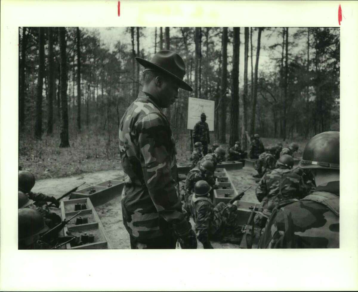Drill Sergeant Staff Sergeant Bobby Moody of Philadelphia, Pennsylvania. He is watching recruits during a land mine instruction course at Fort Benning, Georgia. ...watches his charges...Ft. Benning.