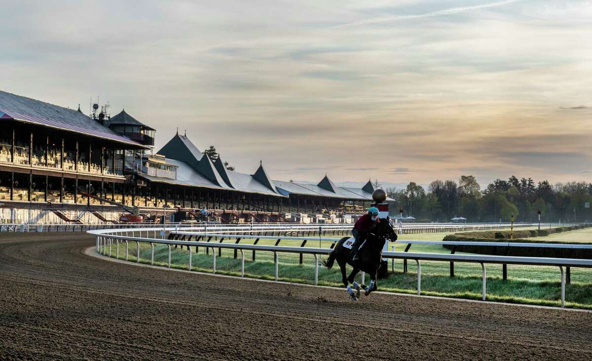 Sales of certain tickets for the 2021 Saratoga Race Course meet begin on Wednesday, June 9. Pictured, a horse trains on the main track at Saratoga Race Course on April 18, 2021.