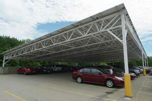 A solar array carport on the parking deck at Bowtie Royale 6 theater plaza at 542 Westport Ave. Wednesday, June 20, 2018, in Norwalk, Conn.