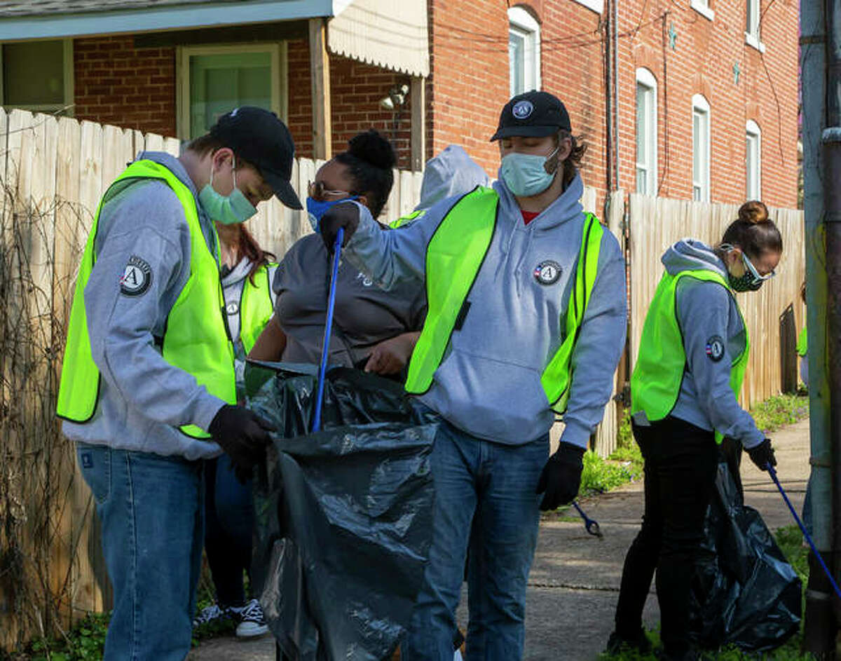 Lewis and Clark Community College's YouthBuild AmeriCorps program students clean up litter in the area around the Scott Bibb Center.