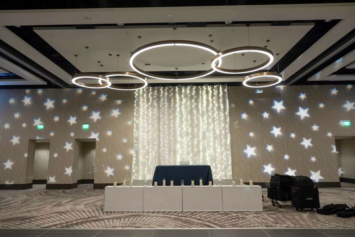The DJ area for the Grand Oaks High School prom is seen at Houston CityPlace Marriott at Springwoods Village, Saturday, April 17, 2021, in Spring. School administrators ensured that they would take measures to prevent the spread of COVID-19.