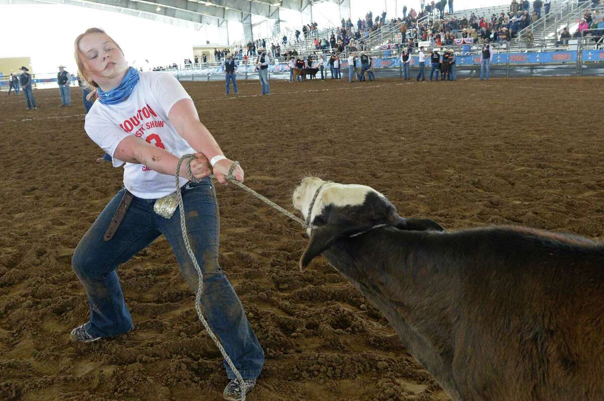 Natalie Putnam of the Gainesville FFA pulls a calf towards the finish line during the 2021 Houston Livestock Show and Rodeo Calf Scramble.