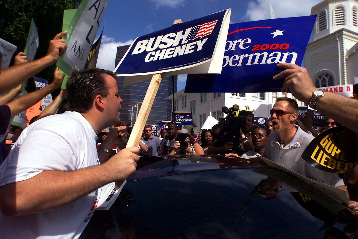 Supporters of Republican presidential candidate Texas Gov. George W. Bush argue with supporters of Democratic presidential candidate Vice President Al Gore outside the County Administration complex Thursday, Nov. 9, 2000, in West Palm Beach, Fla.