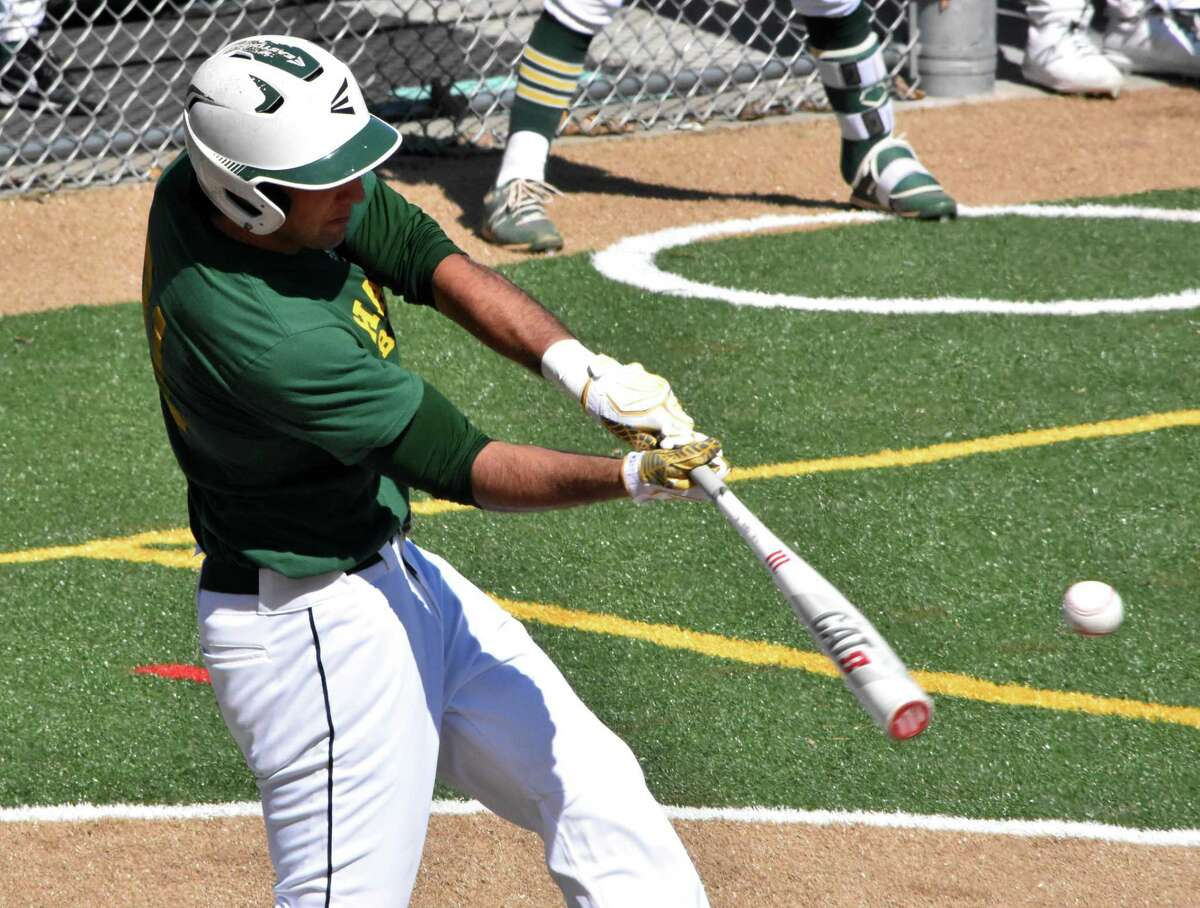 Hamden's Jake Pisano takes a swing against Xavier in a scrimmage at Hamden high on Tuesday, April 6, 2021.