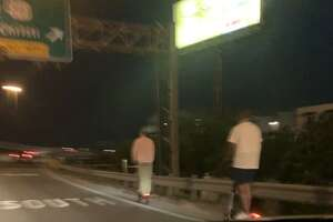 For two San Antonio men, Sunday night cruising meant scootering up the Interstate 35 North ramp to Highway 281 South as cars zipped past.