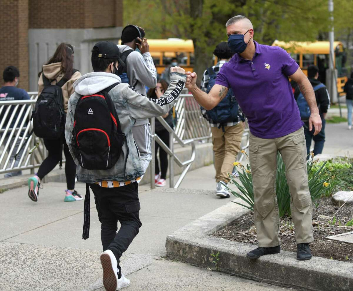 Principal Michael Rinaldi thanks students for a successful return to a full-time in-person schedule at Westhill High School in Stamford on Monday.
