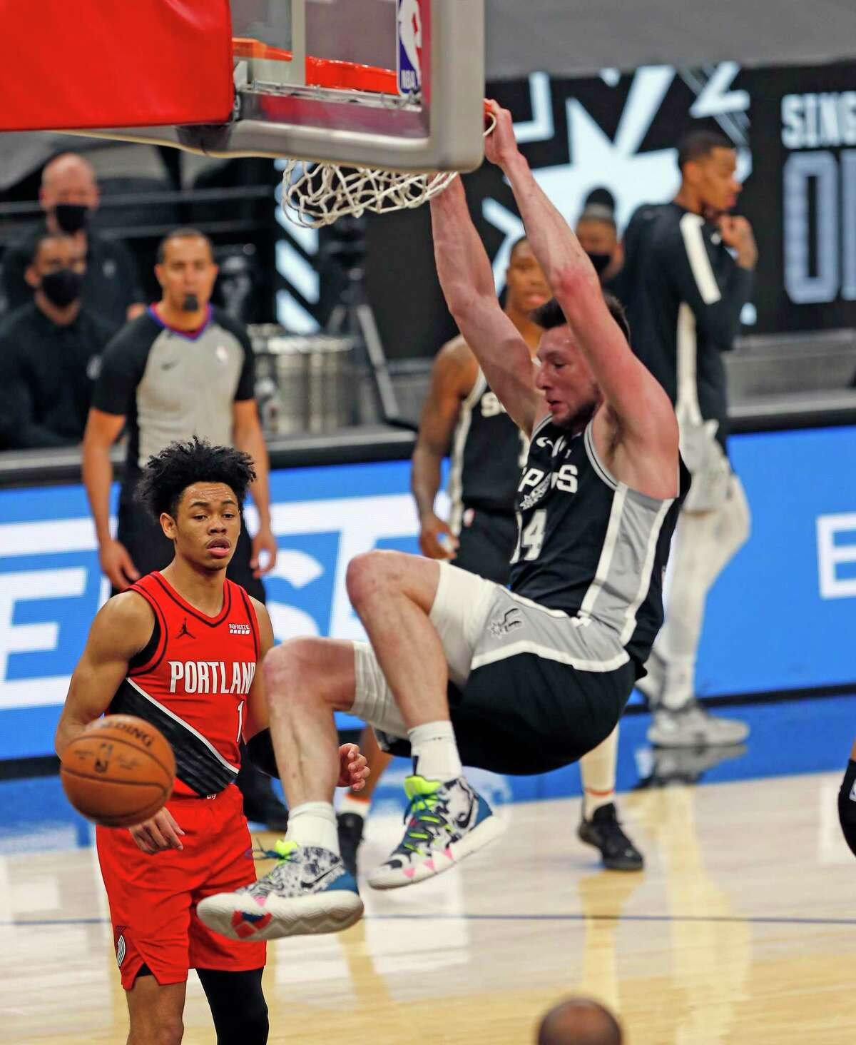 Drew Eubanks of the San Spurs dunks against the Portland Trailblazers in the first half at AT&T Center on April 16, 2021 in San Antonio.