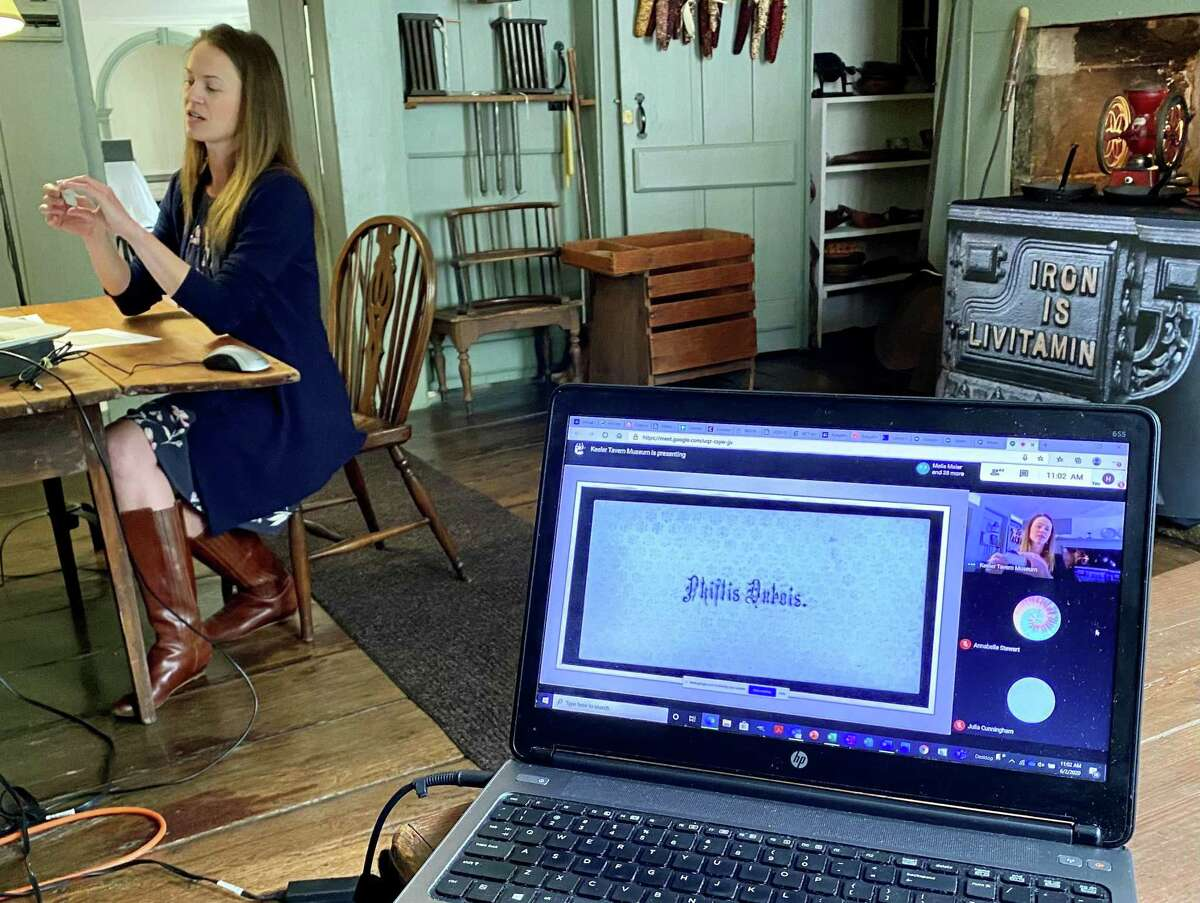 """During a live virtual school program of """"Sisters"""" in Ridgefield, Director of Education Melissa Houston shows students a primary source document from the museum's collection that recently helped staff and playwrights develop a composite of Phillis DuBois."""