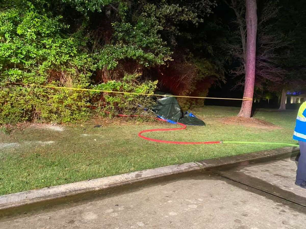The photographs taken by members of The Woodlands Fire Department show the Tesla electric car involved in a fatal crash on April 17. Two people died in the crash, officials report, and the cause is under investigation.