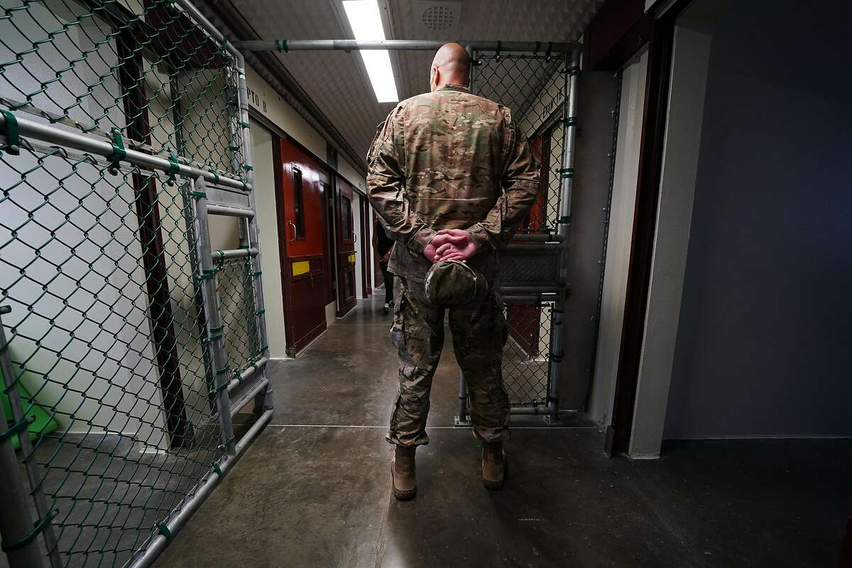 A member of the military walks at the Camp 5 detention center during a media tour at Guantanamo Bay, Cuba, in April 2019.