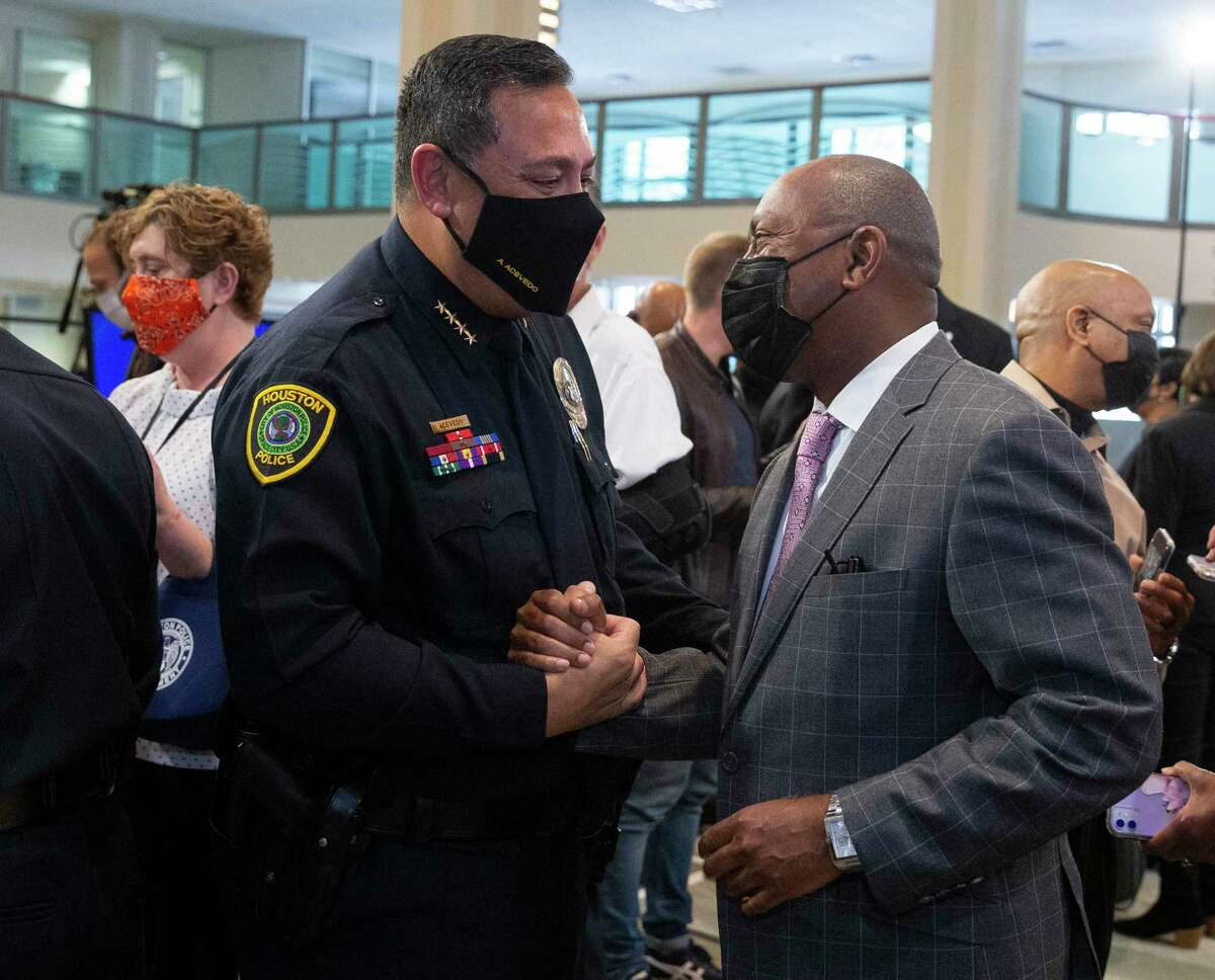 Former Police Chief Art Acevedo and Mayor Sylvester Turner after a press conference in March 2021. Acevedo and the city are both named defendants in a lawsuit filed after the Harding Street raid, which ended in the deaths of Dennis Tuttle and Rhogena Nicholas.
