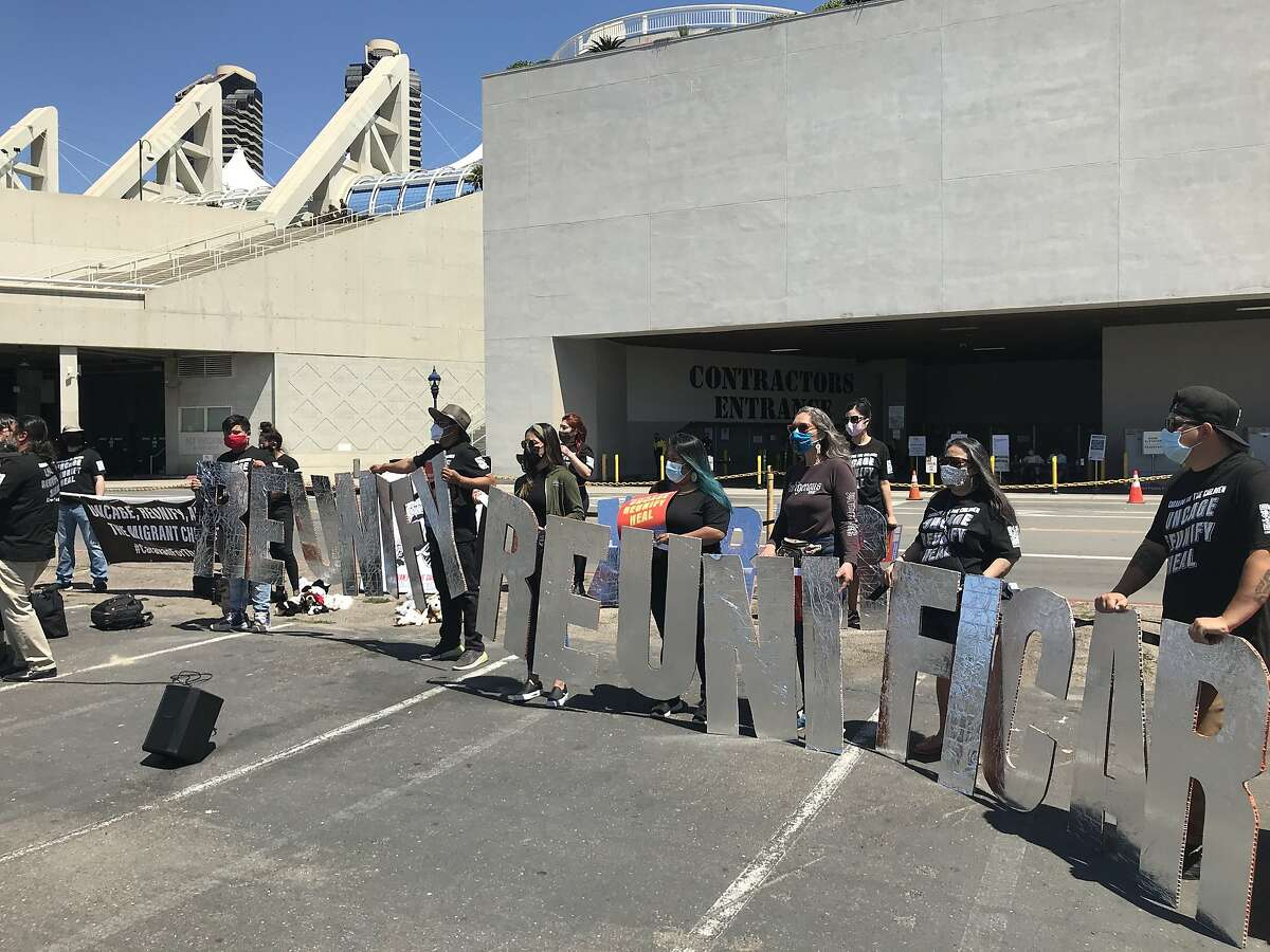 Activists gather outside the San Diego Convention Center, where 1,450 migrant children are being held in a federal shelter after being transferred from overflowing Texas border facilities.