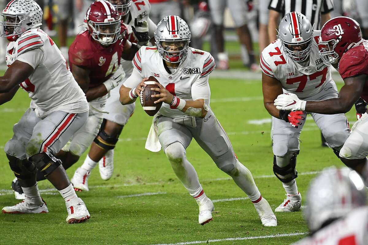 Justin Fields #1 of the Ohio State Buckeyes moves in the pocket during the College Football Playoff National Championship football game against the Alabama Crimson Tide at Hard Rock Stadium on January 11, 2021 in Miami Gardens, Florida. The Alabama Crimson Tide defeated the Ohio State Buckeyes 52-24.