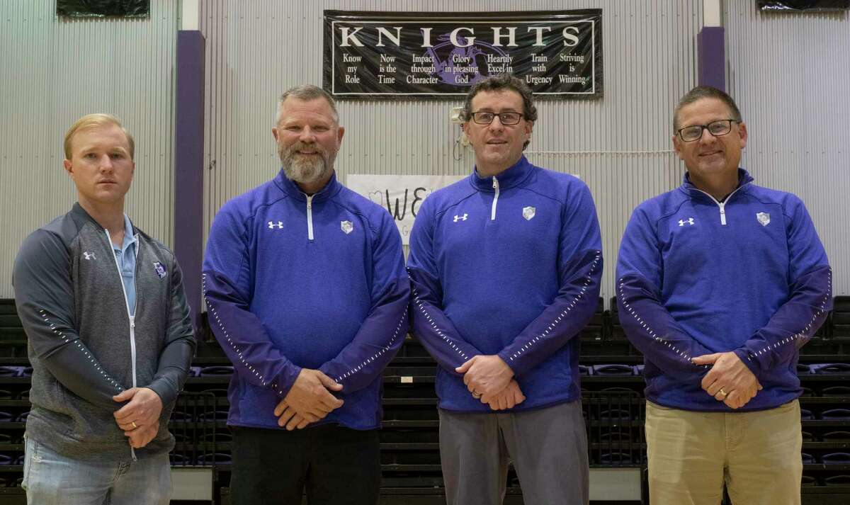 Midland Classical Academy's coaching staff, Tyler Stallings, MRT Coach of the Year Ron Miller, Steve Beattie and Jeff Patterson. 04/19/2021. Tim Fischer/Reporter-Telegram
