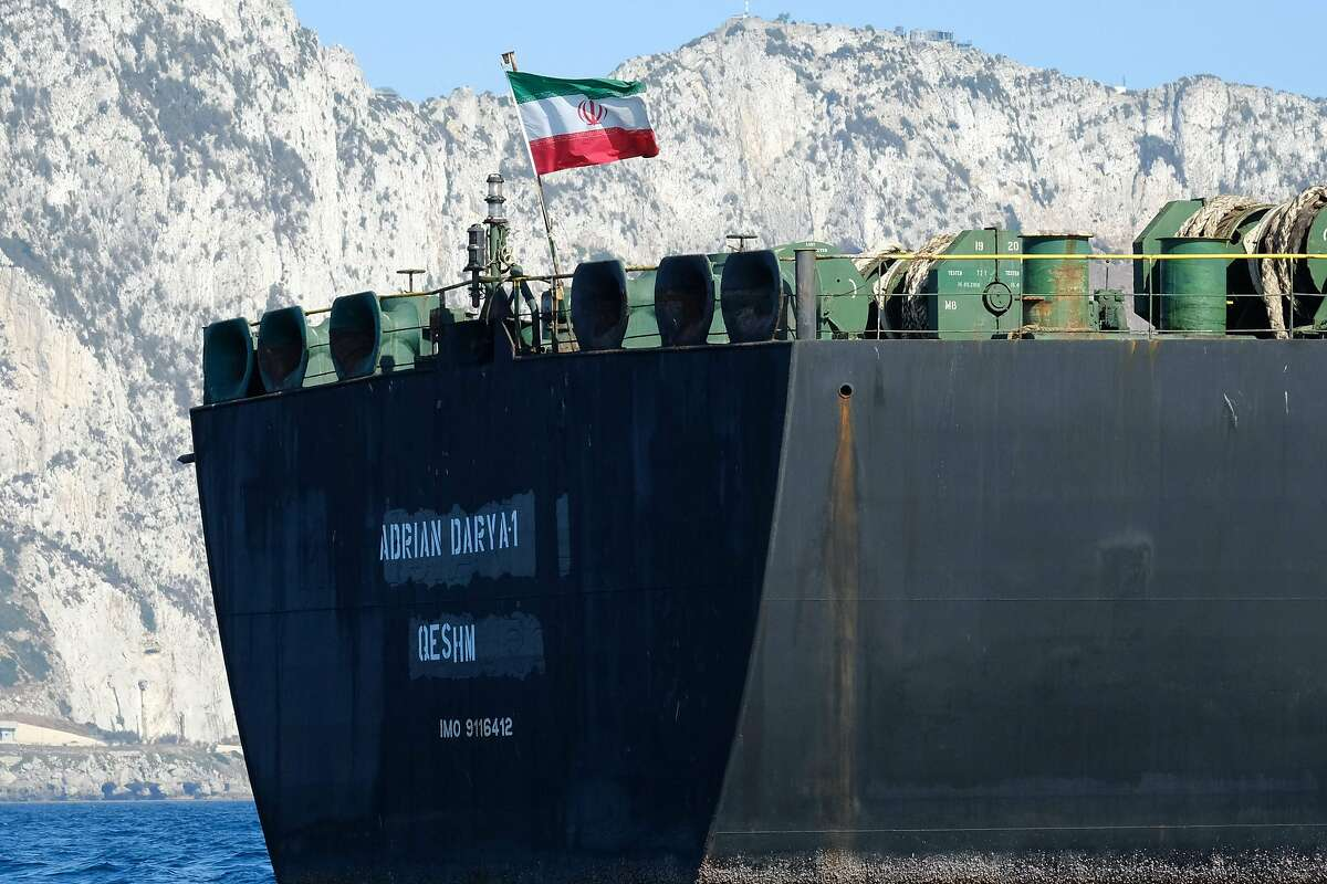 An Iranian flag flutters on board an oil tanker.