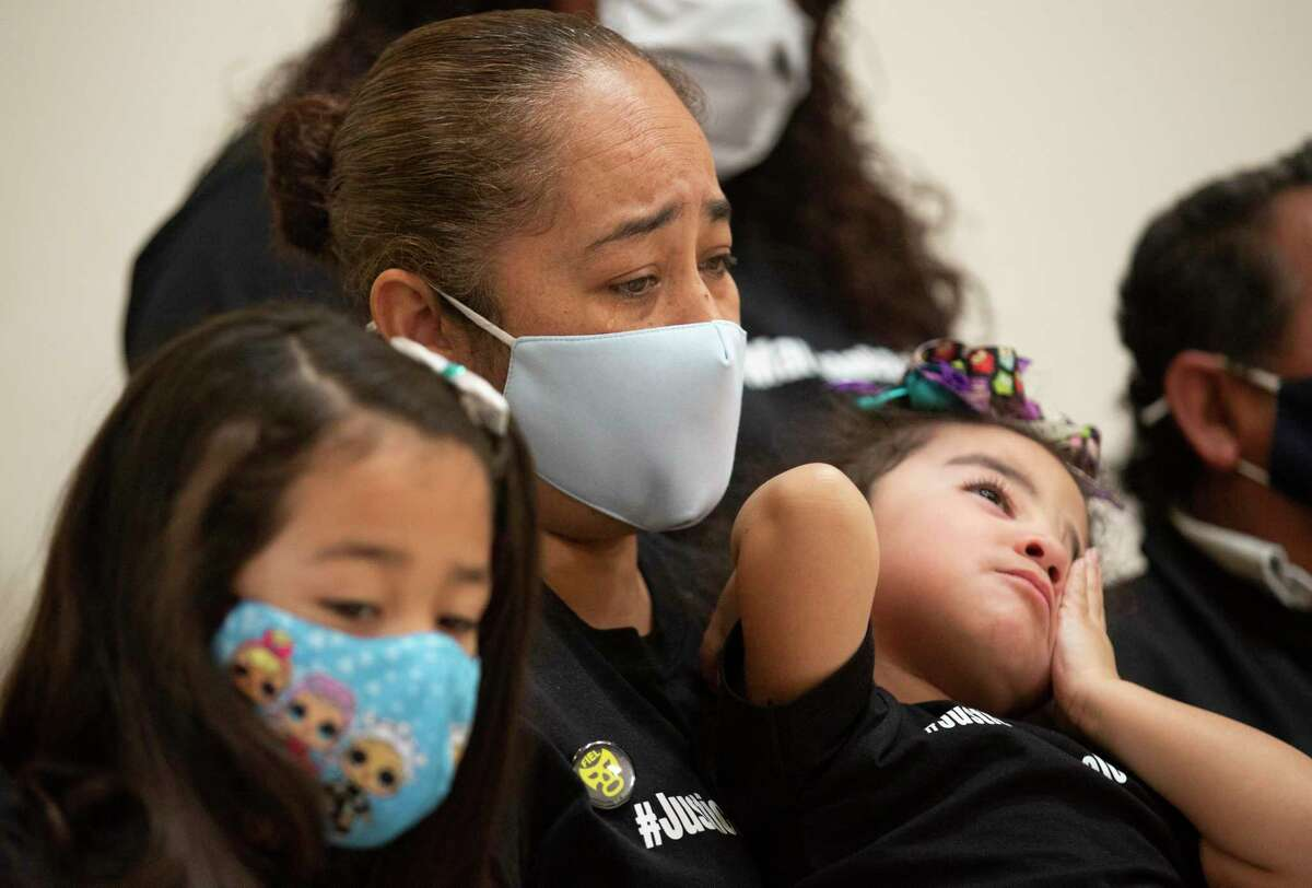 Luciana Garcia, left, widow of Marcelo Garcia, holds her youngest daughter, Mary Hope Garcia, 2, during a press conference asking Harris County Sheriff Ed Gonzalez to realease the body camera footage of Marcelo's case Monday, April 19, 2021, in Houston. Luciana and her three daughters were present when Marcelo Garcia, 45, was shot and killed by a sheriff's deputy during an mental health crisis. Family said they called the mental health unit but a sheriff's deputy responded instead.