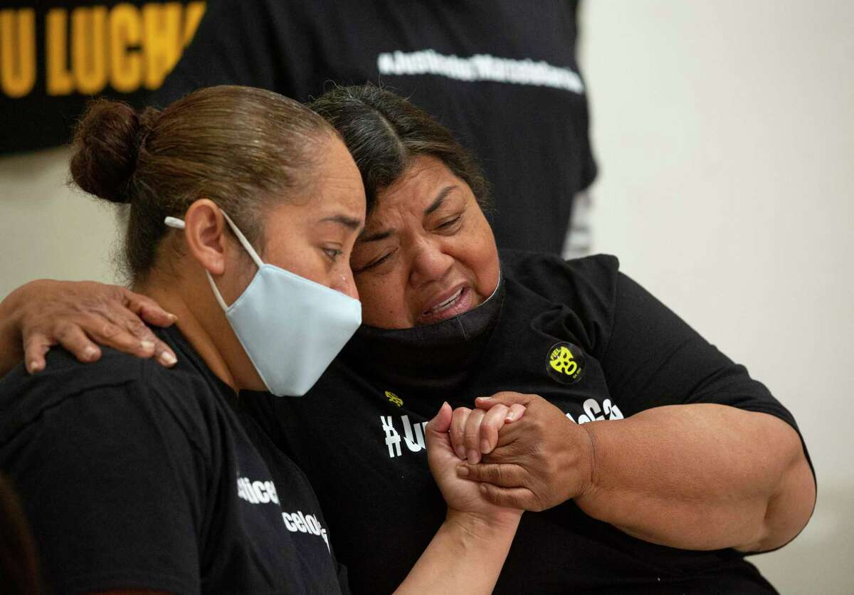 Luciana Garcia, left, widow of Marcelo Garcia, and her mother-in-law, Mariel E. Garcia, hold each other with emotions folloinwg a press conference calling Harris County Sheriff Ed Gonzalez to realease the body camera footage of Marcelo's case during a press conference Monday, April 19, 2021, in Houston. Marcelo Garcia, 45, was shot and killed by a sheriff's deputy during an mental health crisis. Family said they called the mental health unit but a sheriff's deputy responded instead.