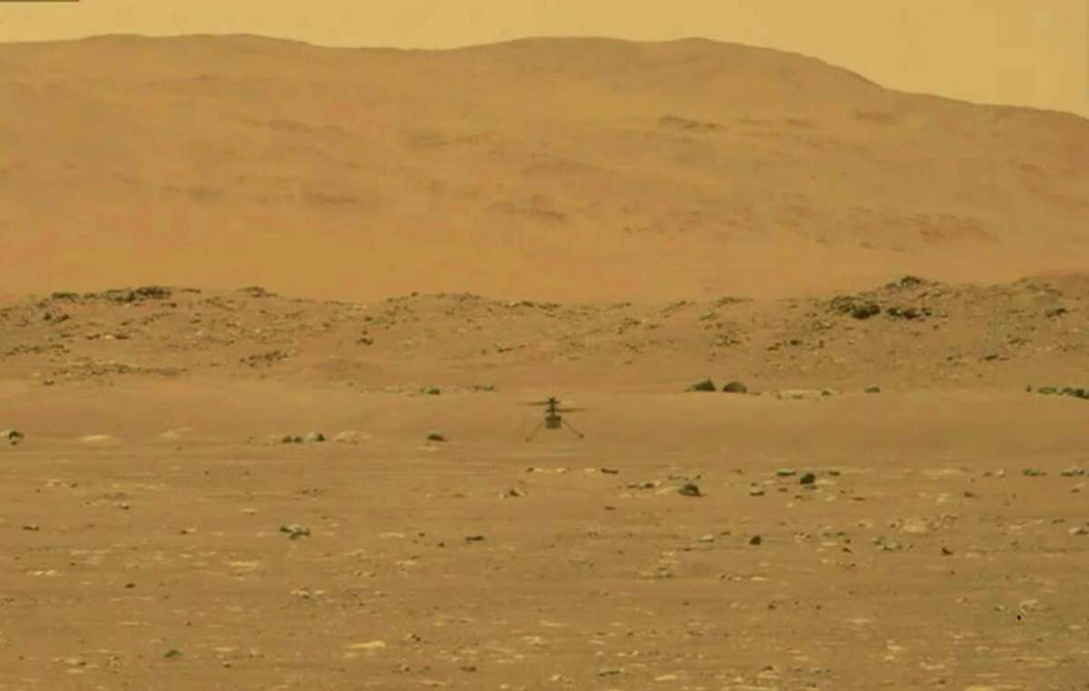 An image provided by NASA during the Ingenuity helicopter's first flight on Mars, Monday, April 29, 2021, which lasted less than 60 seconds and reached a height of about 10 feet. The brief test of the experimental vehicle shows how explorers can study the red planet from the sky as well as the ground. (NASA via The New York Times) - FOR EDITORIAL USE ONLY.