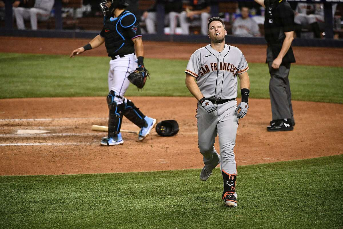 The Giants' Buster Posey is hit by a pitch from Sandy Alcantara of the Miami Marlins in the seventh inning at loanDepot on Saturday.