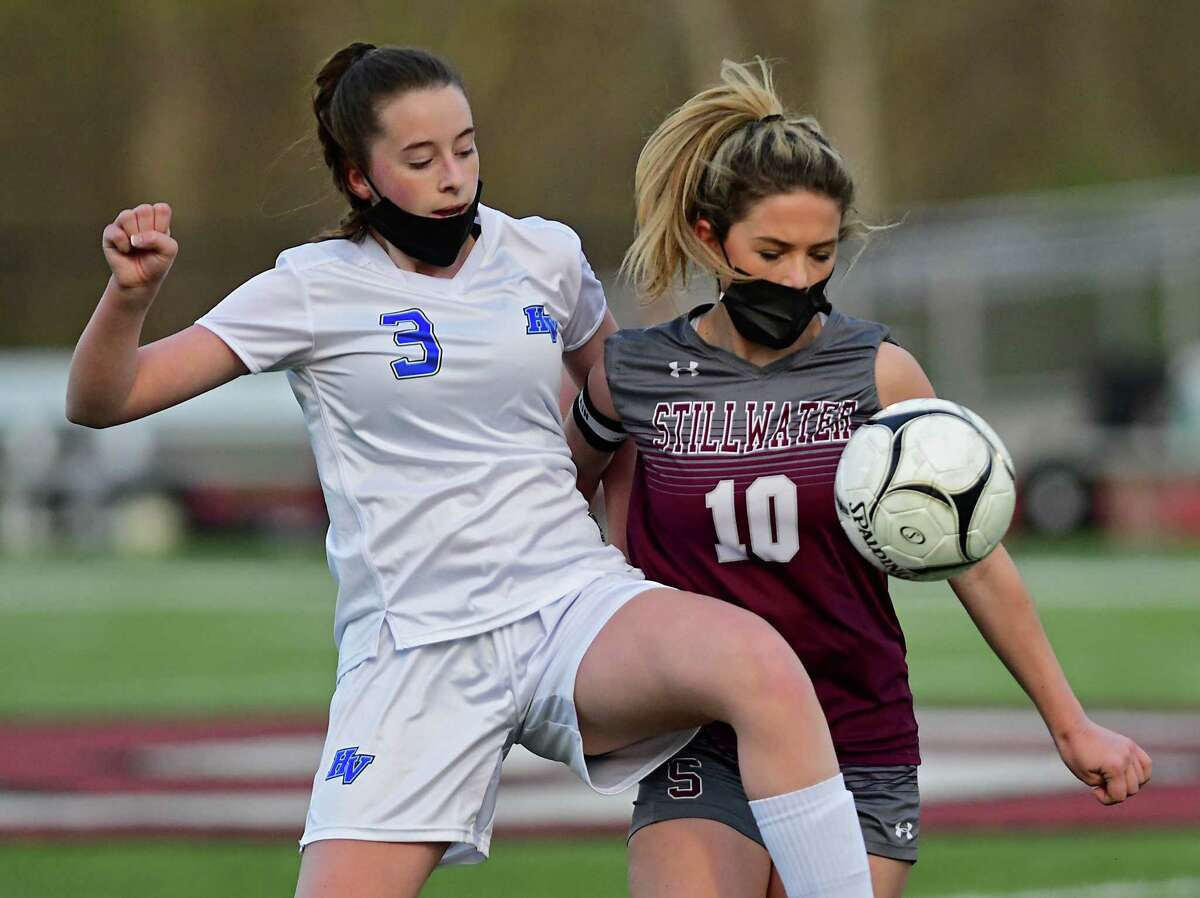 Hoosic Valley's Jaquelyn Carlo, left, and Stillwater's Devon Wagner battle for the ball during a soccer game on Monday, April 19, 2021 in Stillwater, N.Y. (Lori Van Buren/Times Union)
