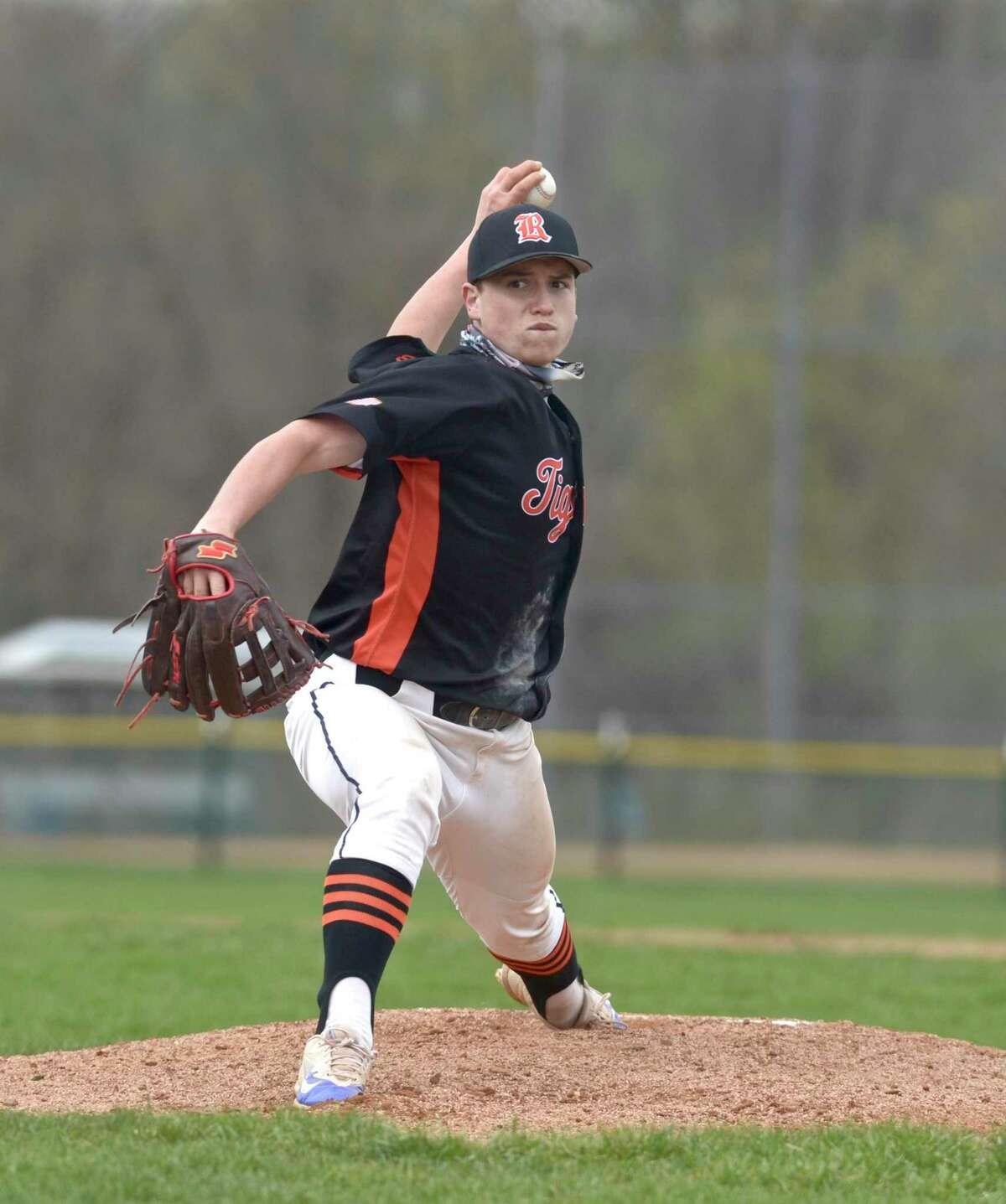 Ridgefield's Luke D'Antonio (1) pitches in the first inning of the boys baseball game between Ridgefield and Danbury high schools, Monday April 19, 2021, at Danbury High School, Danbury, Conn.