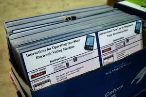 Laminated instructions for operating an electronic voting machine Friday, Sept. 25, 2020, at NRG Arena in Houston.