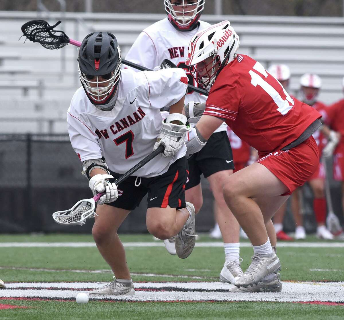 New Canaan's Hayden Shin (7) and Fairfield Prep's Ted Bednar (17) scramble for the ball on a faceoff during a boys lacrosse game at Dunning Field on Monday, April 19, 2021.