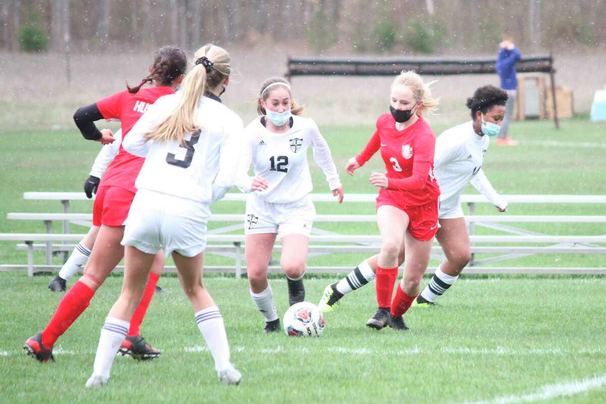 The Huskies battled the Lakers in girls soccer on a snowy Monday evening. (Robert Myers/Record Patriot)