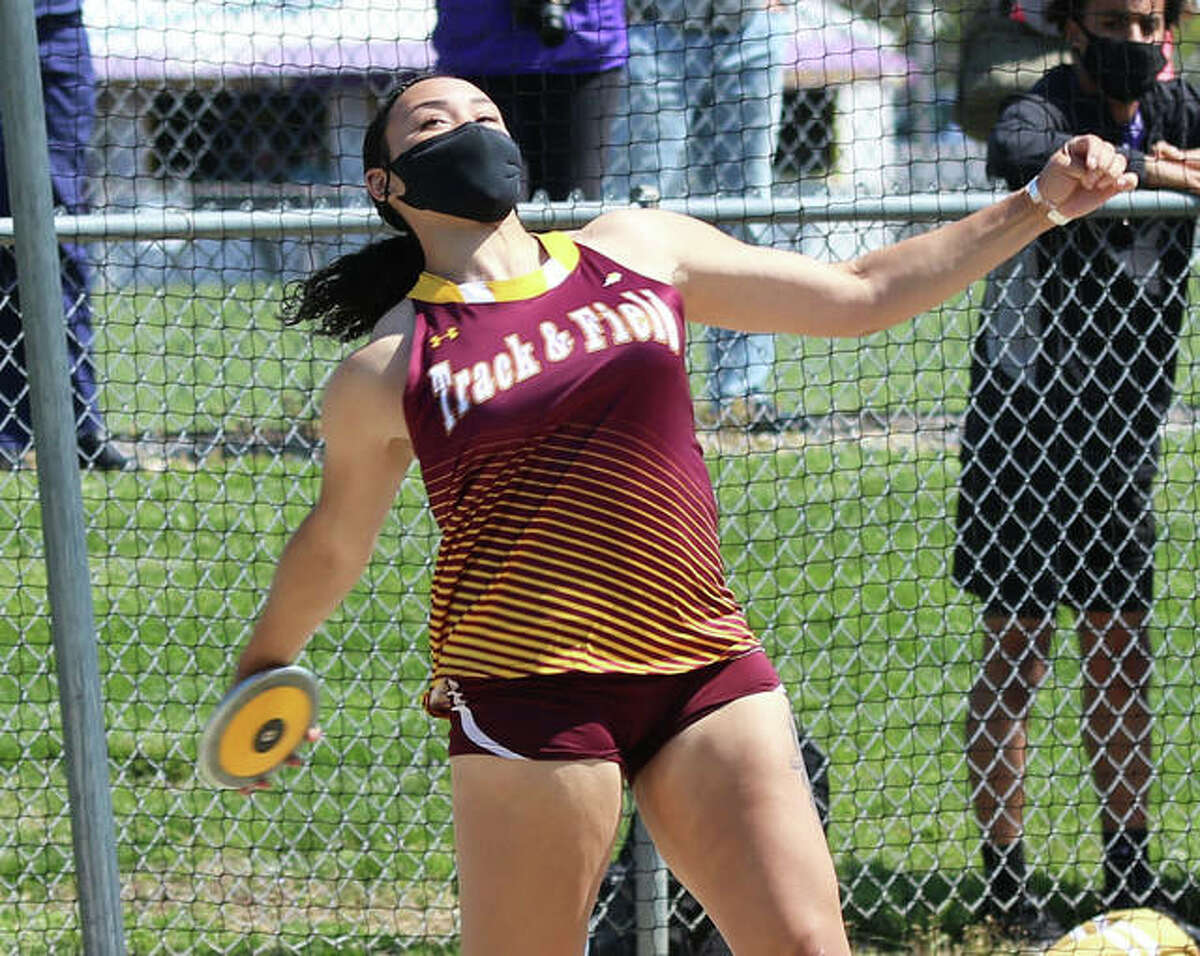 EA-WR senior Jayden Ulrich lets the discus fly a school record 153 feet, 8 inches on her third and final throw Monday afternoon in a girls track quadrangular meet at Civic Memorial High School in Bethalto.