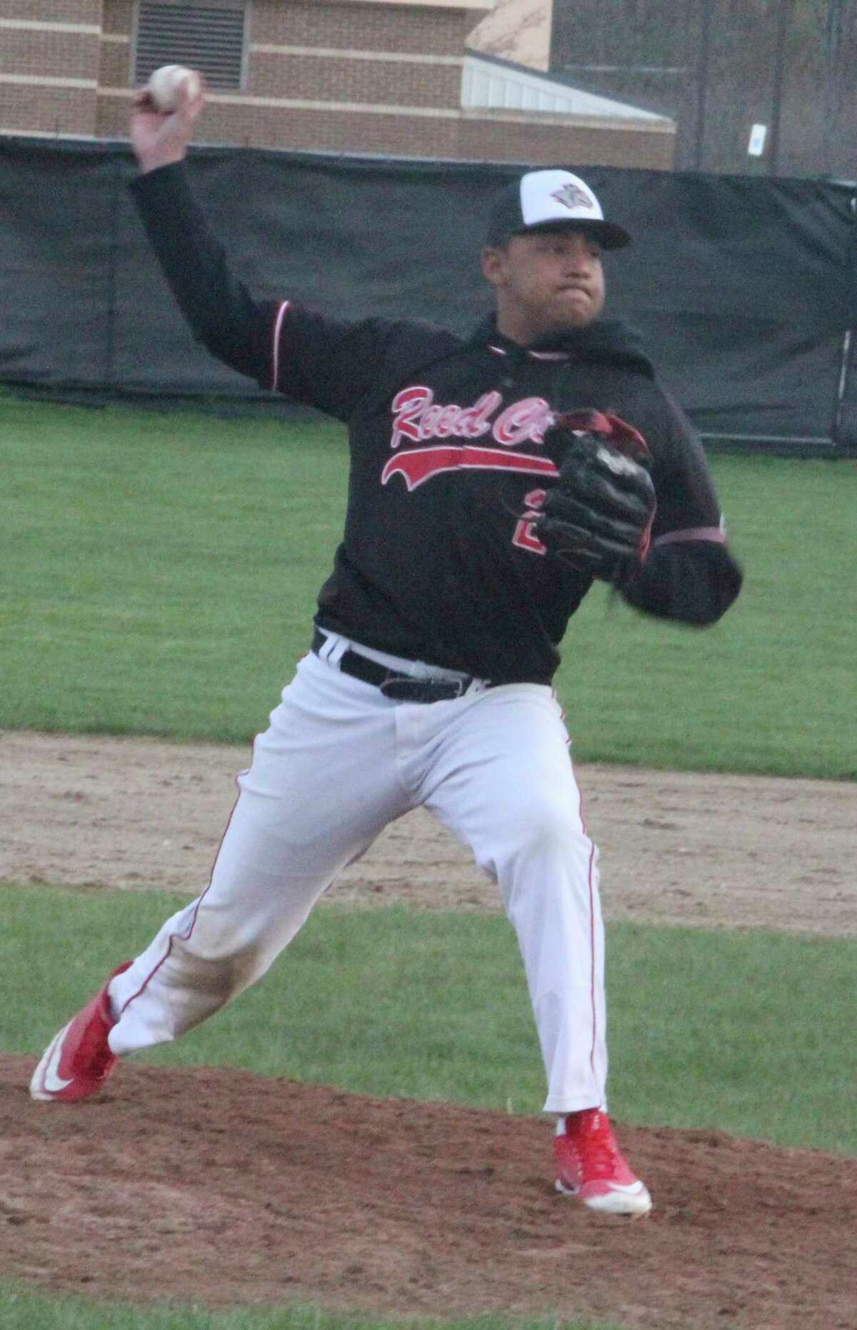 Isaiah Morgan delivers a pitch for Reed City against Cadillac. (Pioneer photo/Jonn Raffel)