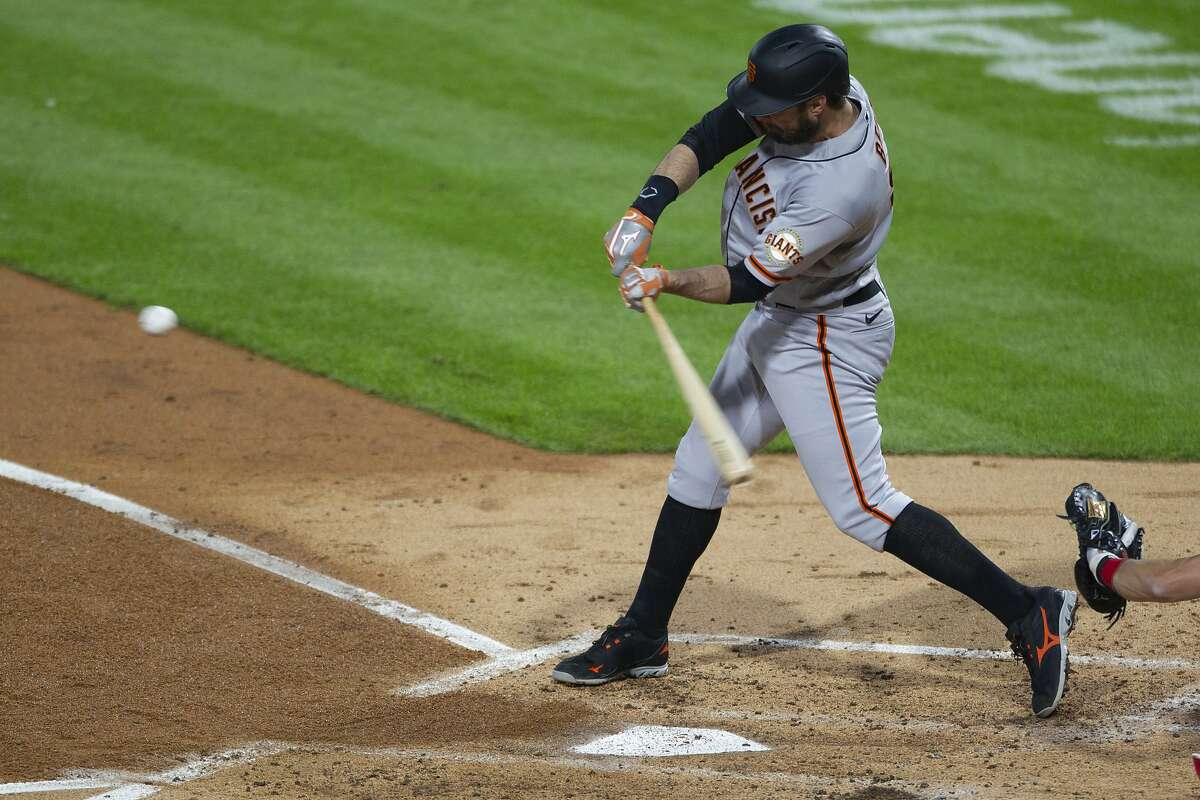 The Giants' Brandon Belt hits a two-run homer in the third, which stood up in a 2-0 victory.