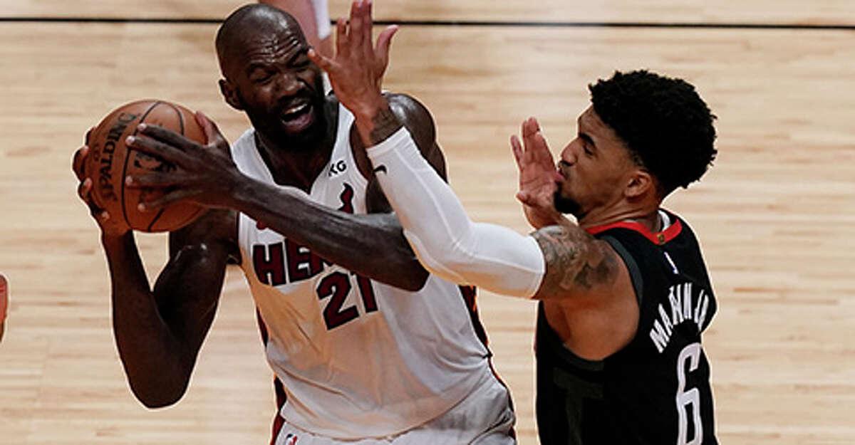 Houston Rockets forward Kenyon Martin Jr. (6) defends Miami Heat center Dewayne Dedmon (21), during the second half of an NBA basketball game, Monday, April 19, 2021, in Miami. (AP Photo/Marta Lavandier)