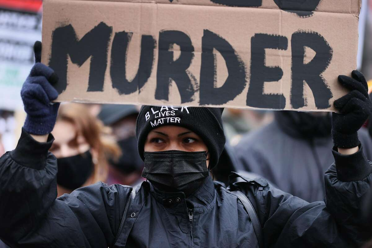 A demonstrator near the courthouse in Minneapolis on Monday, when the case against Derek Chauvin went to a jury.