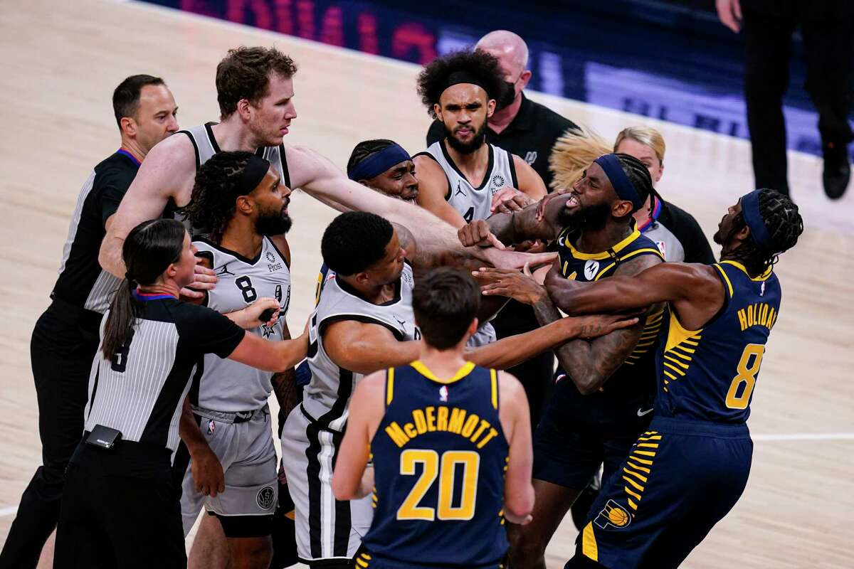 Pacers forward JaKarr Sampson (14) and San Spurs guard Patty Mills (8) exchange words during the second half of an NBA basketball game in Indianapolis, Monday, April 19, 2021. Sampson was ejected from the game.