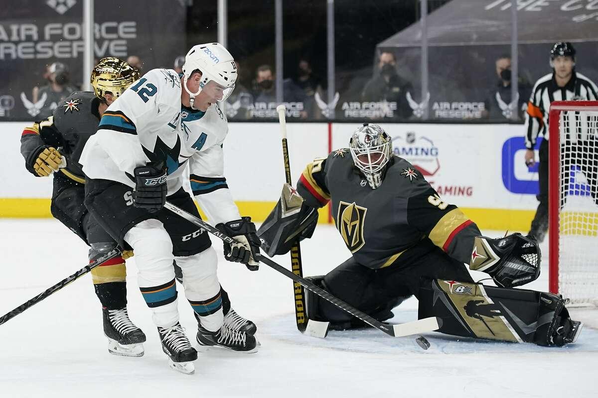 San Jose Sharks center Patrick Marleau (12) attempts a shot on Vegas Golden Knights goaltender Robin Lehner (90) during the first period of an NHL hockey game Monday, April 19, 2021, in Las Vegas. (AP Photo/John Locher)
