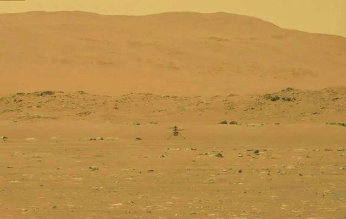 NASA's experimental Mars helicopter Ingenuity lands Monday on the surface of Mars. The 4-pound helicopter rose from the dusty red surface into the thin Martian air, achieving the first powered, controlled flight on another planet.
