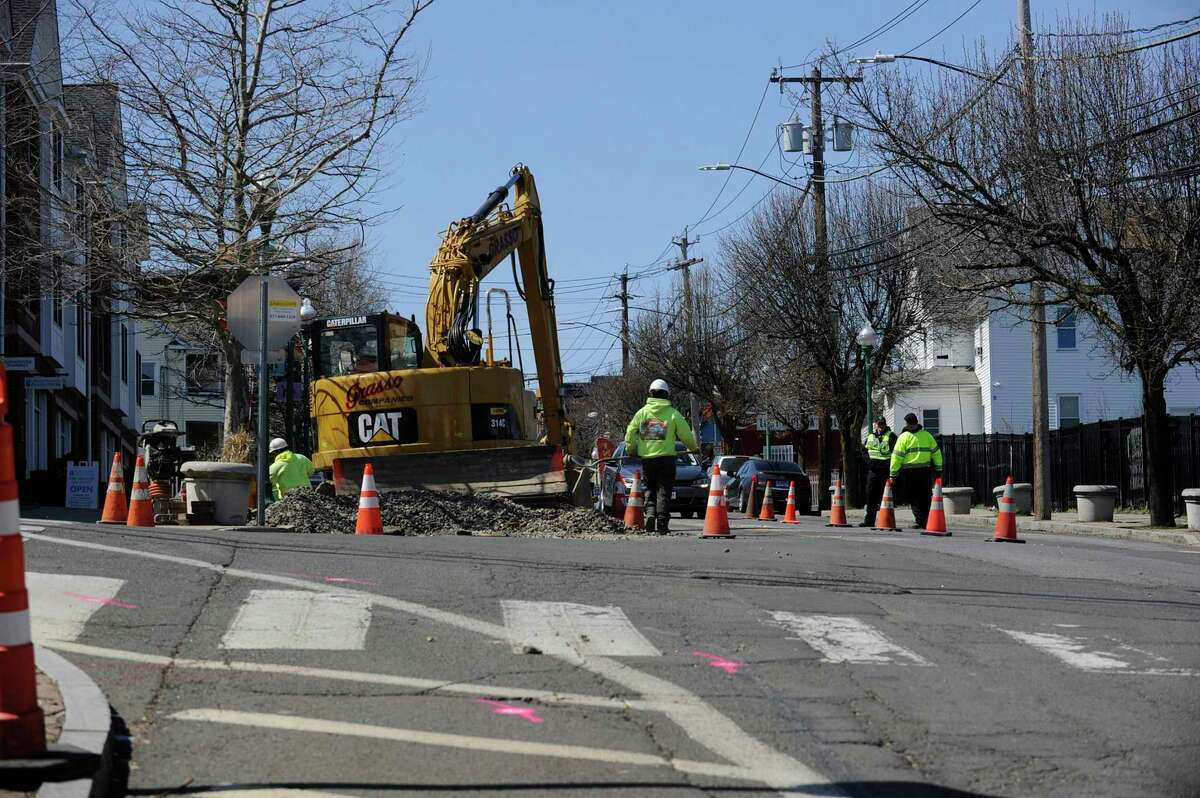 A construction crew works along Stillwater Avenue on Thursday, April 4, 2019 in Stamford, Connecticut. According to the City of Stamford's website, 11 streets are set to be paved this year with Stillwater listed among five streets that are slated to be re-paved in their entirety.