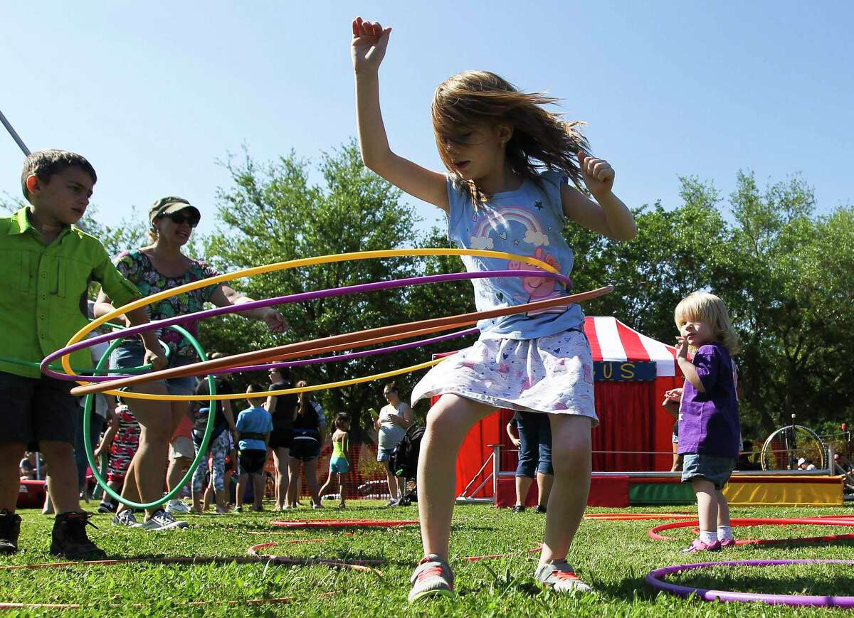 Emily Kielman works on her hula hoopingskills during the annual KidzFest, Saturday, April 27, 2019, in downtown Conroe. The free, which attracts more than 15,000 people, offered a variety of activates, interactive games, performances and booths. This year's event is set for Saturday.
