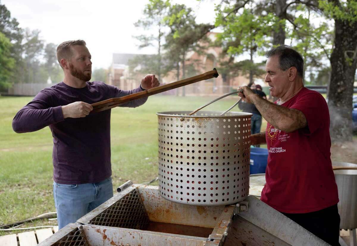 Travis Sneed, left and John Mattern prepare to boil crawfish during a crawfish boil fundraiser at St. Matthias Catholic Church, Saturday, April 17, 2021, in Magnolia. Volunteers prepared over 825 lbs of crawfish and 220 lbs of shrimp. Funds raised will be used for the cost of their new church.