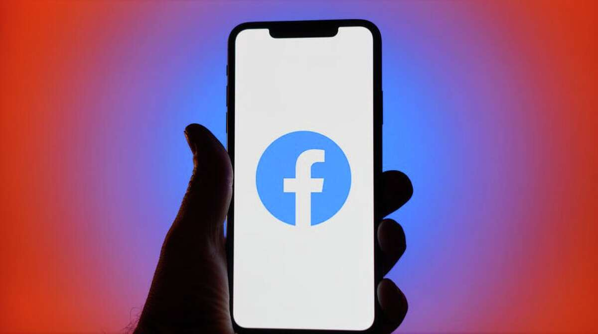 In this file photo, the Facebook logo is shown on a mobile phone.