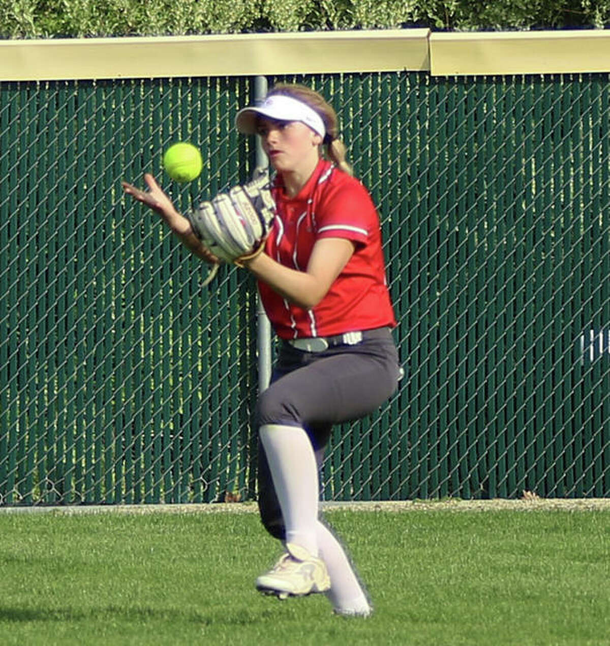 Alton right fielder Lauren O'Neill bobbles a fly ball, but makes the catch against Triad on Monday at Alton High in Godfrey.