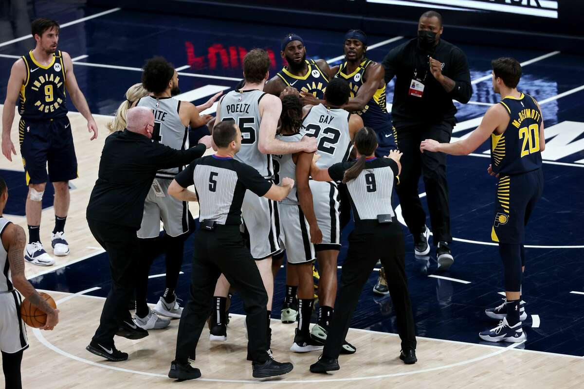 Spurs players Patty Mills and Rudy Gay will have to pay thousands for their roles in the squabble with the Indiana Pacers on Monday night.