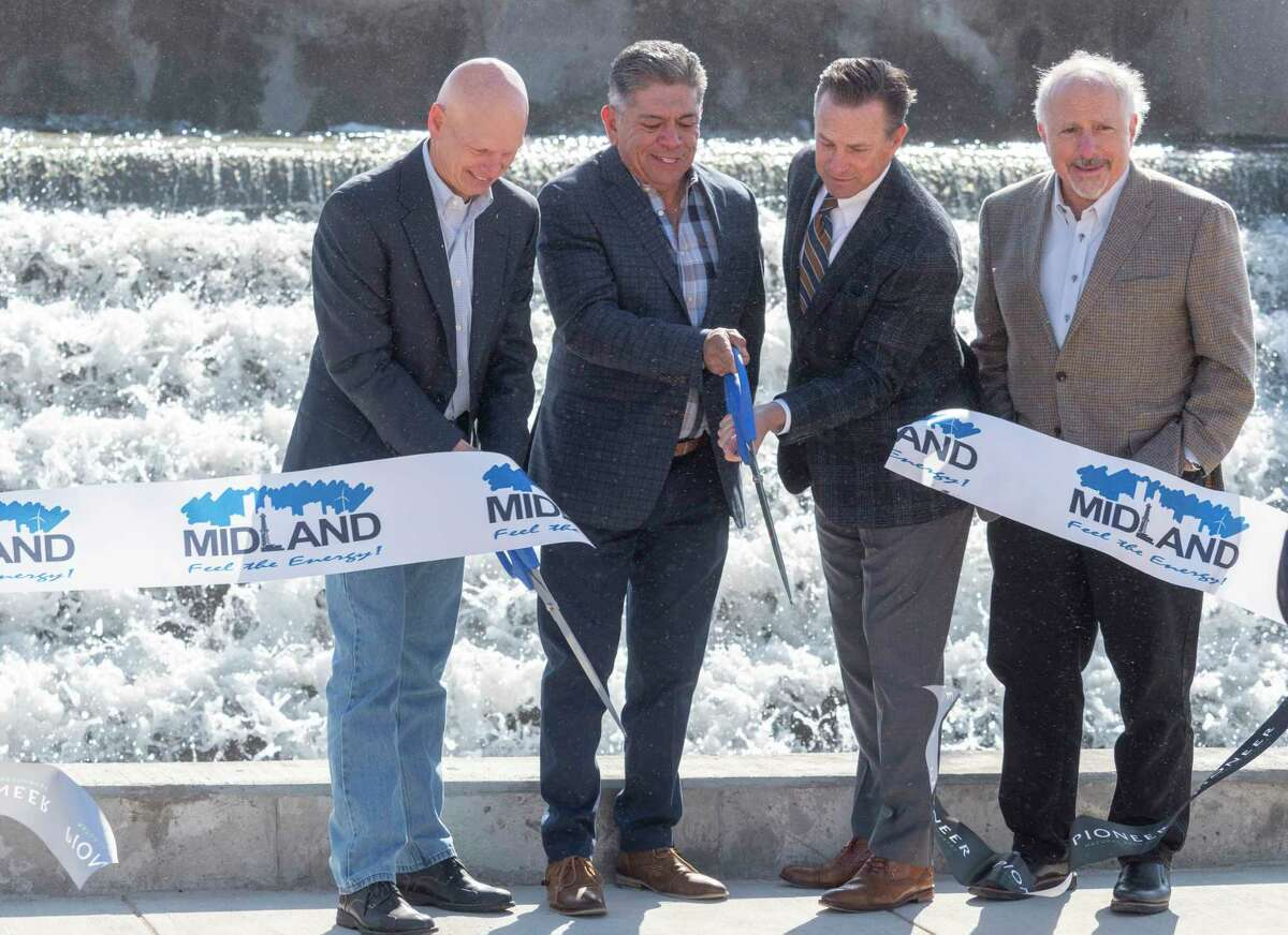 Richard Dealy, President and Chief Operating Officer, former mayor Jerry Morales, Mayor Patrick Payton and Mark Berg, Executive Vice President, Corporate Operations with Pioneer Natural Resources, cut the ribbons 04/20/2021 at the kick-off event of the joint venture of Pioneer Natural Resources and City of Midland at the City of Midland Water Reclamation Facility. Pioneer will soon be able to utilize 240,000-250,000 barrels of water a day for drilling purposes after cleaning the waste water at the facility. Tim Fischer/Reporter-Telegram