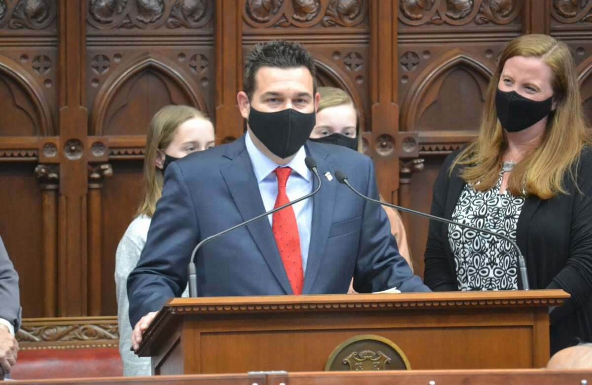 State Rep. Tony Scott (R-112) was sworn in for his first term at the State Capitol in Hartford April 19 alongside his wife, Jennifer, and two daughters, Lauren and Addison.