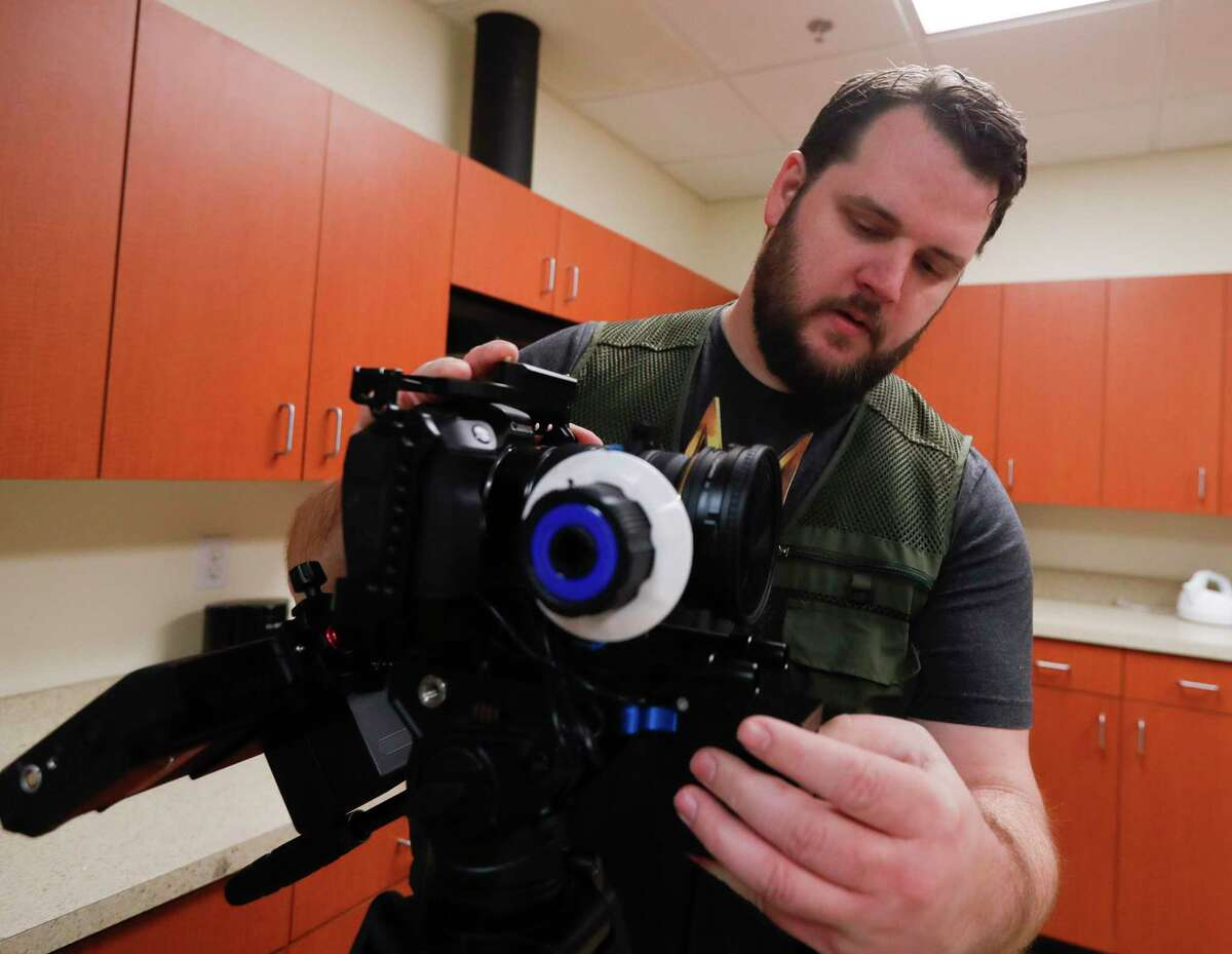 Cinematographer Jake Allen prepares gear before the filming of Breaking Strongholds, a new streaming series in Montgomery County, Saturday, April 10, 2021, in The Woodlands.